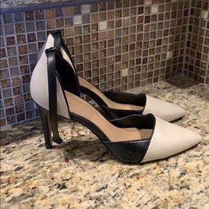 Nude/ Black colored heels